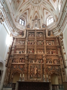 Enjoy the gorgeous Baroque altar in contrast with the Rococo ceiling.